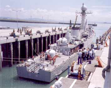 A 1,800 metric ton naval vessel being prepared to be lifted.
