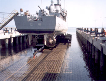 a linear chain jack system moving a large ship via a shiplift system